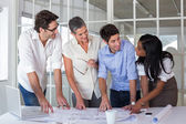 Architects going over blueprints — Stock Photo
