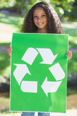 Environmental activist holding a poster — Stock Photo