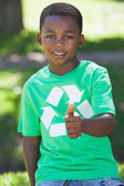 Boy in recycling tshirt showing thumb up — Stock Photo
