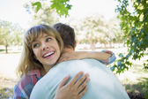 Blonde hugging boyfriend — Stock Photo