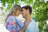 Couple hugging in the park — Stock Photo