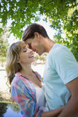Cute couple hugging in the park — Stock Photo