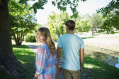 Couple walkingd in the park — Stock Photo