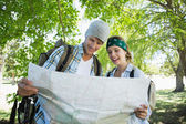Couple on a hike consulting the map — 图库照片