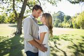 Couple embracing in park — Stock Photo