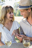 Man placing ring on fiancees finger — Stock Photo