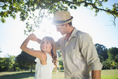 Couple dancing in the park — Stock Photo