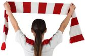 Football fan waving scarf — Stock Photo