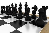Black chess pieces on board — Stock Photo