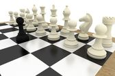 Black pawn facing white pieces — Stock Photo