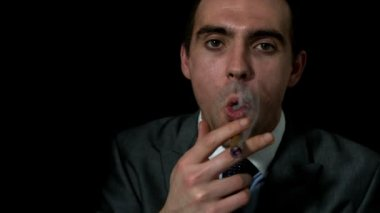 Businessman smoking his cigar — Stockvideo