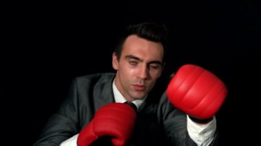 Businessman punching with red gloves — Stock Video