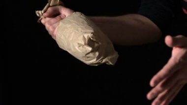 Hand popping flour bag — Stock Video