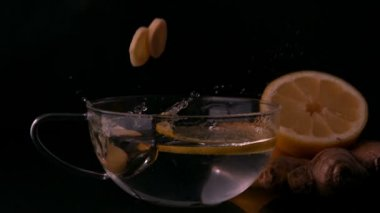 Lemon slices falling into glass cup — Stock Video