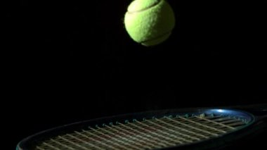 Tennis ball bouncing on racket — Stock Video