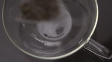 Teabag falling into glass cup — Stock Video