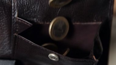 Coins falling into leather wallet — Stock Video