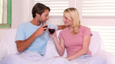 Couple sitting having red wine — Vídeo de Stock