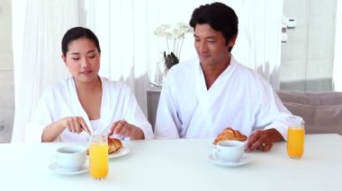 Asian couple having breakfast — Stock Video