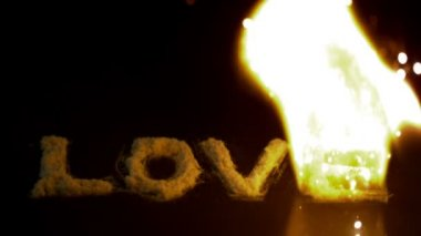 Fire burning up word love — Stock video