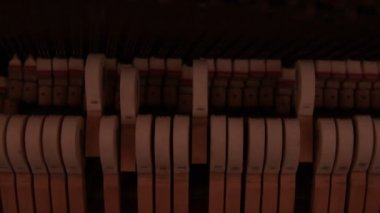 Piano hammers hitting strings — Stock Video
