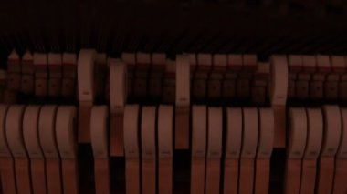 Piano hammers hitting strings — Stok video