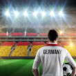 Composite image of germany football player holding ball — Stock Photo #48247129