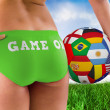 Girl in bikini holding flag footbal — Stock Photo #48248703