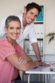 Business team using computer — Stock Photo