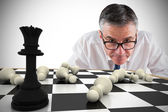 Focused businessman with chessboard — Stock Photo