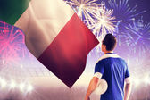 Italian football player against fireworks — Stock Photo