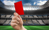 Hand holding up red card — Stock Photo
