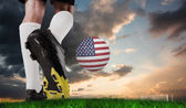 Football boots against green grass — Stockfoto