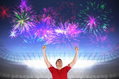 Excited football player cheering — Stock Photo