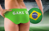 Fit girl holding brasil ball — Stock Photo