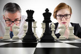 Business people and chessboard — Stock Photo