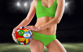 Fit girl holding flag ball — Stock Photo