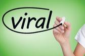 Businesswoman writing word viral — Stock Photo