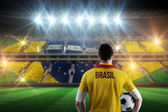 Brasil football player holding ball — Stock Photo