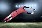 Fit goal keeper jumping up — Stock Photo