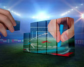 рука, строительство стены против футбола — Стоковое фото