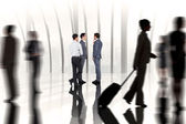 Businessmen standing agains large window — Stock Photo