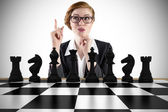 Thinking businesswoman with chessboard — Stock Photo
