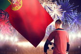 Goalkeeper holding ball against fireworks — Stock Photo