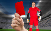 Hand holding up red card to goalie — Stock Photo