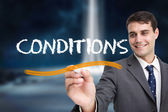 Businessman writing word conditions — Stock Photo
