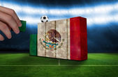 Hand building wall of mexico flag — Stock Photo