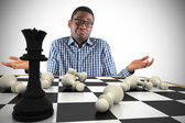 Businessman shrugging shoulders with chessboard — Stock Photo