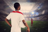 Football players facing off in large stadium — Stock Photo