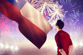 Football player against fireworks — Stock Photo